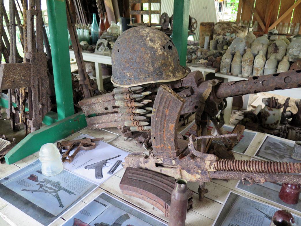 2527-Machine-gun-and-helmet-at-Peter-Joseph-WWII-Museum-Munda-diving-Solomon-Islands-DPI-2527