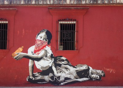 {A new Lapiztola stencil went up while we were gone. This lovely niña was here to greet us when we returned.}
