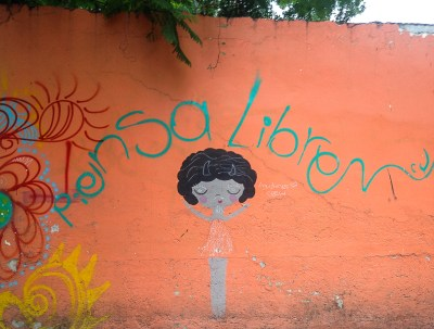 """{Street art on the way to the grocery store. """"Think Free""""}"""
