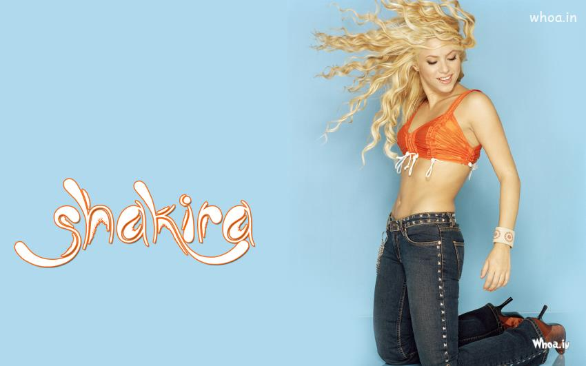 Cute Wallpapers With Friendship Quotes Wallpaper Of Shakira With Orange Top On A Blue Background