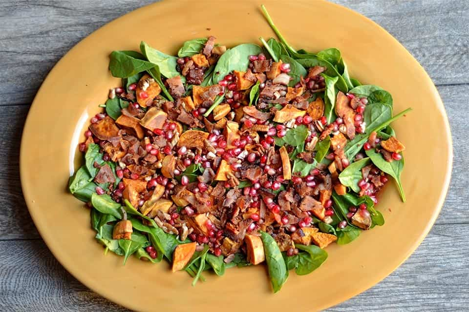 spinach, pomegranate seeds, roasted sweet potatoes, bacon, and a warm ...