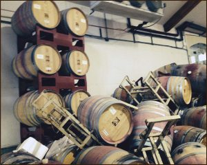 Barrels stacked on plastic racks in Napa cellar close to the epicenter of the August 2014 quake.