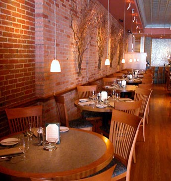 the old brick walls, oak flooring, simple seating, kinda the idea - restaurant statement