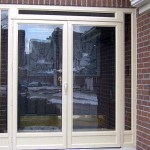 Cream colored front porch enclosure in Brampton