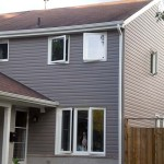 Heart Lake, dark grey vinyl siding