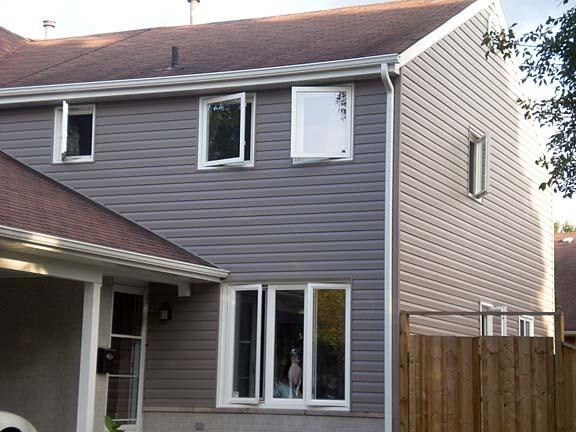 Dark grey vinyl siding interesting home exterior design for Grey vinyl siding colors