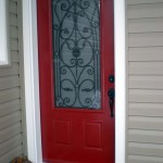 red-front-door-with-wrought-iron-inside-glass