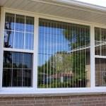 Single hung vinyl windows with internal grills