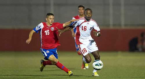 Photo: Trinidad and Tobago national under-17 midfielder and T&TEC FC player Levi Garcia (right) takes on a Costa Rican opponent. (Courtesy CONCACAF)
