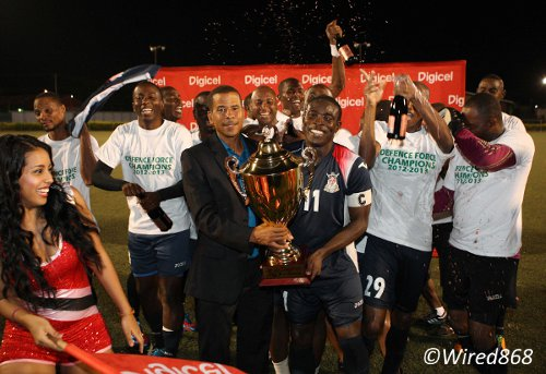 Photo: Pro League CEO Dexter Skeene hands the league trophy over to stand-in Defence Force captain Kevon Carter. (Courtesy Wired868)