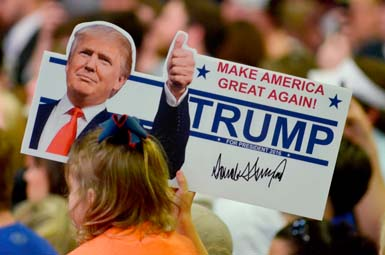A young supporter holds up a campaign sign for U.S. Republican Presidential candidate Donald Trump at Madison Central High School during at a campaign rally in Madison, Mississippi. — PHOTO:  REUTERS/Rick Guy