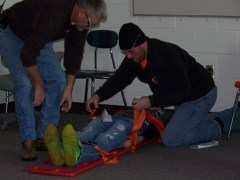 "Emergency responders load this ""victim"" on a backboard to be quickly evacuated from the school"