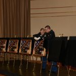 Personalized shadow box displays of seven fallen soldiers are unveiled to family members and friends during a remembrance ceremony at Valparaiso University.