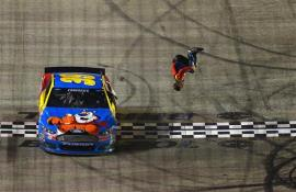 Carl Edwards, driver of the #99 Kellogg's/Frosted Flakes Ford, celebrates with a backflip after winning the NASCAR Sprint Cup Series Food City 500 at Bristol Motor Speedway on March 16, 2014 in Bristol, Tennessee. Photo by Drew Hallowell/Getty Images
