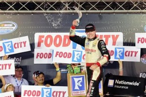 Ryan Blaney, driver of the #22 Discount Tire Ford, celebrates in Victory Lane after winning the NASCAR Nationwide Series Food City 300 at Bristol Motor Speedway on August 22, 2014 in Bristol, Tennessee. Photo by Patrick Smith/Getty Images