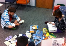 Students in the Knox JAG class sanitize and organize books for distribution. Photo provided.