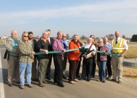 Starke County officials cut the ribbon to officially open the intersection of State Road 8 and County Road 300 East.