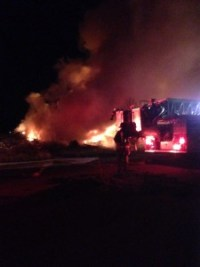 Firefighters extinguished a fire at the location of the old Hacker Shack building.
