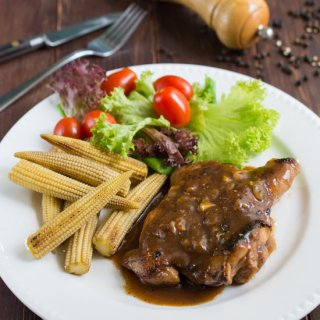 Chicken Chop with Black Pepper Sauce - Delicious grilled marinated chicken covered with a rich, bold black pepper sauce.