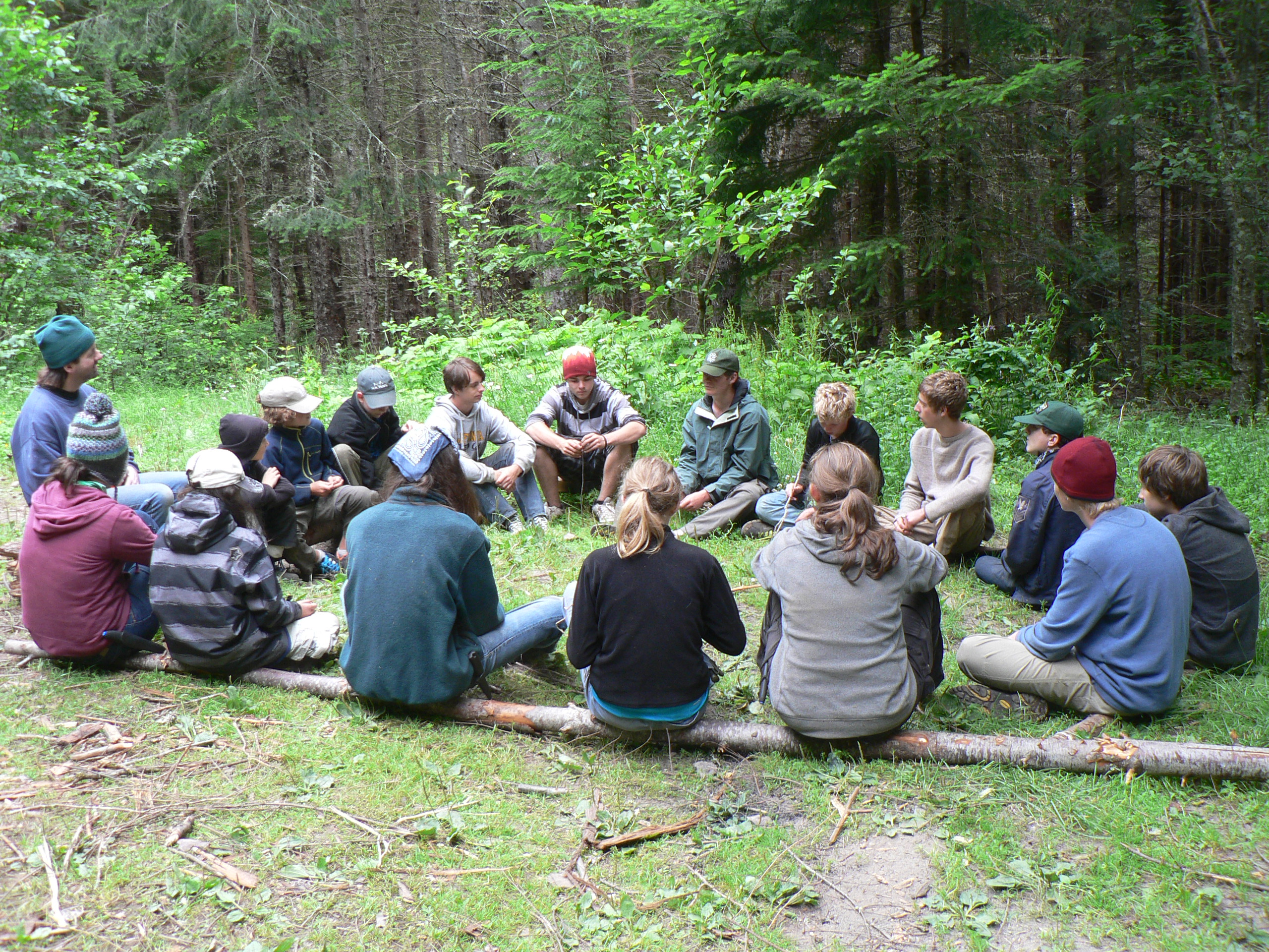 Survivalists Circle up for a Debrief after an Exhilirating Trek