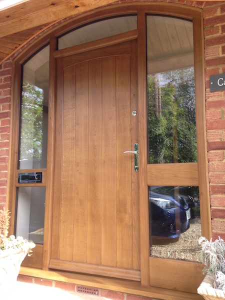 Solid oak front door with curved frame woodcraft