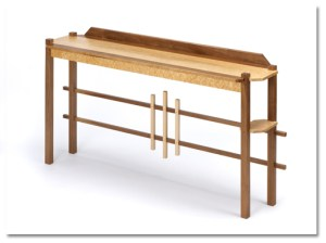 """Bruce's Hall/Entry table is made of birdseye maple and walnut. It measures 34"""" H x 67"""" L x 16"""" W."""