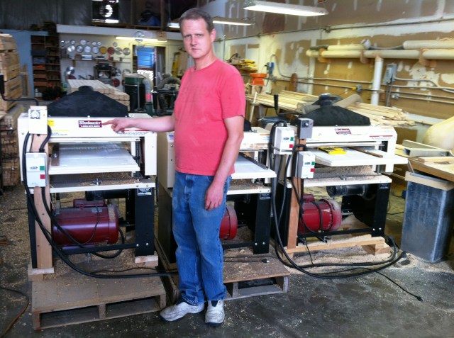 """Andy McQuatters with the three Woodmaster Molder/Planers in the shop he and his dad operate in Florida, """"Andy's Place."""""""