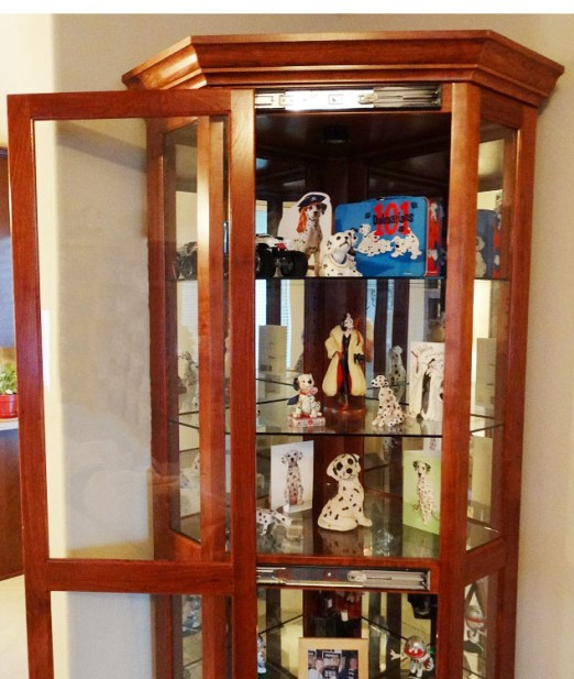 "Ed's finished curio cabinet houses his wife's collection of ""1,001 Dalmations"" collectibles and memorabilia. Note the cabinet door SLIDES sideways to open. Nicely done, Ed!"