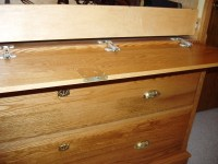 gun cabinet disguised as a dresser