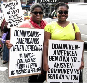 In Spanish and Creole, signs read, 'Dominican-Americans have rights; Haitian-Dominicans have the same rights.'WW photo: G. Dunkel