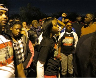 Wearing glasses, center, Leslie McSpadden, Michael Brown's mother, leads Ferguson march. WW photo: Monica Moorehead