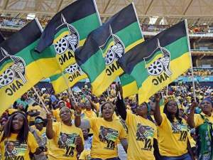 Supporters of the African National Congress (ANC) cheer during their party's final election rally in Soweto.