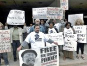 Supporters of Rev. Edward Pinkney demonstrate in Grand Rapids, Mich., demanding he be released on bond.