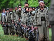 Kurdistan Workers' Party (PKK) fighters arrive in the northern Iraqi city of Dohuk.