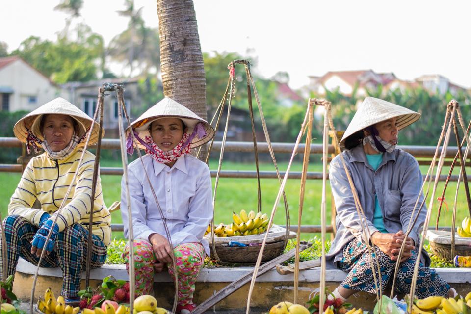 Vietnamese women in cone hats