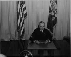 Harry Truman at Desk Announcing End of WWII By Abbie Rowe, 1905-1967, Photographer