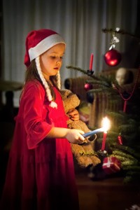 Lighting Christmas Tree candles in Prezelle - @World Travel Mama