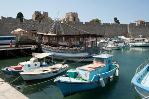 boats in the harbor at Rhodes Old Town - @World Travel Mama