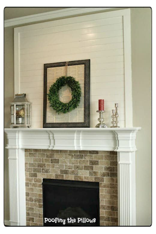 Adding faux shiplap planks above a mantel