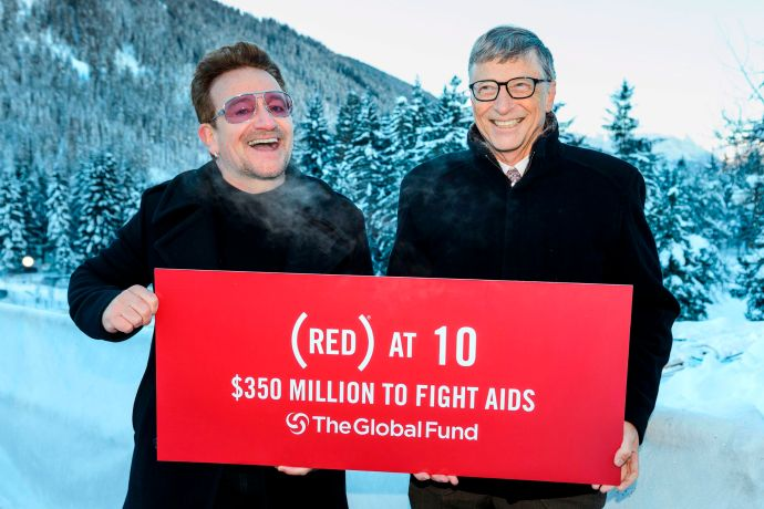 Singer of Irish band U2, Bono (L) poses with Bill Gates at the World Economic Forum annual meeting on January 22, 2016 in Davos to mark the 10 years of (RED).  Launched at Davos in 2006, (RED) has raised $350 million for the Global Fund to fight AIDS, impacting 60 million lives.  / AFP / FABRICE COFFRINI        (Photo credit should read FABRICE COFFRINI/AFP/Getty Images)