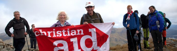 The Munros Challenge, one of Christian Aid's 70 anniversary events in 2015.  Seventy Munros in all parts of Scotland will be tackled during the year.  Walkers on the South Glen Shiel Ridge in Scotland, 19 September 2015.  The ridge has seven Munros & was the most demanding walk of the Challenge.  (A Munro is a mountain more than 3000 feet (914 metres) in height, named after Hugh Munro, the first person to compile a list of them, in 1891.)  Seventy-year-olds Sue & Barry Petitt were part of the group that completed the 27km route in 11 hours.     [ CE2015 ]