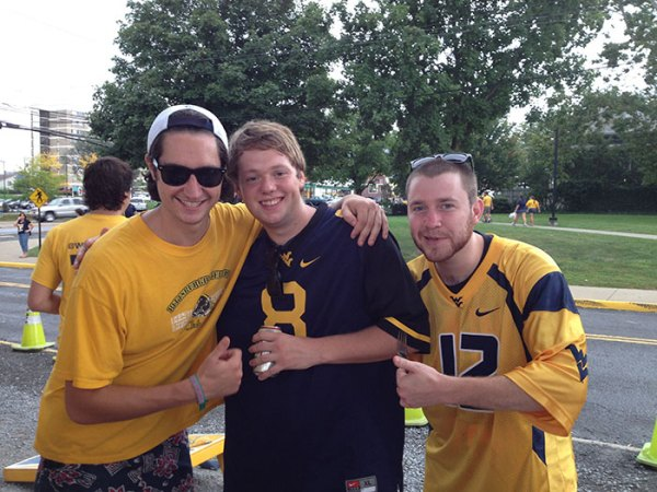 (L-R) Austin, a Pitt grad who never misses a WVU game, Andrew and Dylan Adamek