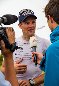 Chrigel being interviewed at the end of the 2013 Red Bull X-Alps