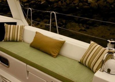 Yacht Upholstery Green and Pillows Brown and Stripes