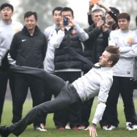 David Beckham fell over in a suit and everyone took a photo