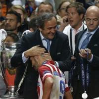 Soccer: Platini hits back at British daily's Qatar claim