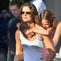 Katie Holmes' daughter Suri Cruise gets a ride on mommy's shoulders as they hit Disneyland for thrilling family outing