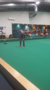 John having a go at indoor bowls for the first time