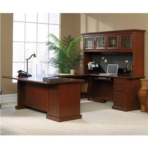 many times people will arrange their desks so that each of the three work areas has its own function usually this means one is for the computer and its