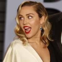 Miley Cyrus and Liam Hemsworth Cuddle at 2018 Vanity Fair ...
